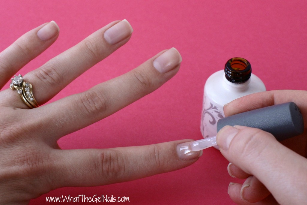 How to Do Gel Nails at Home. Paint on base coat and cure in UV or LED lamp.
